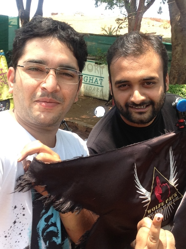 Sourabh and Amit with the Wolfe Pack flag